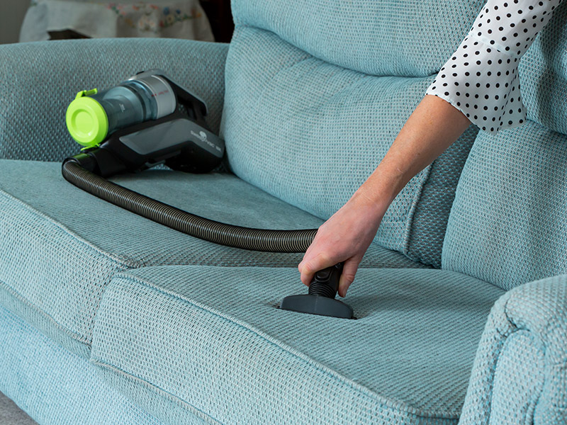 Stickvac Using Flexible Hose on Couch